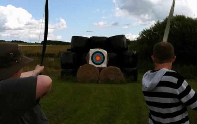 archery with two people at house of mulben