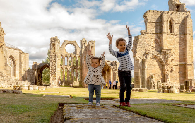 Children playing outside Elgin Cathedral