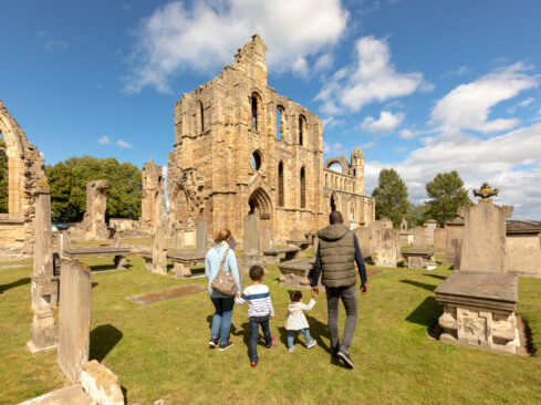 A family outside Elgin Cathedral