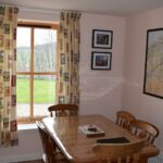 Picture of dining table within Moray Cottages
