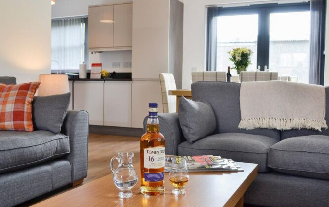 Picture of Cairn Daimh living room with whisky