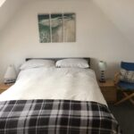 A double bed in Beach House FIndochty