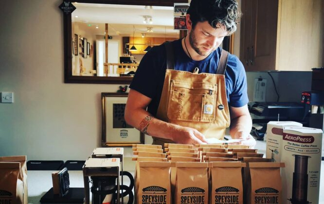 Picture of a man packaging coffee beans