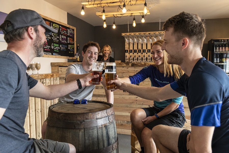 a small group enjoying a beer at Windswept Brewery