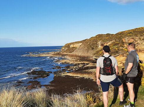 runner looking at coastal view