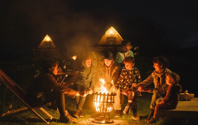 Picture of children around a camp fire