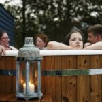 Picture of family in hot tub at The Loft