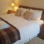Image of Carden Holiday Cottages bed