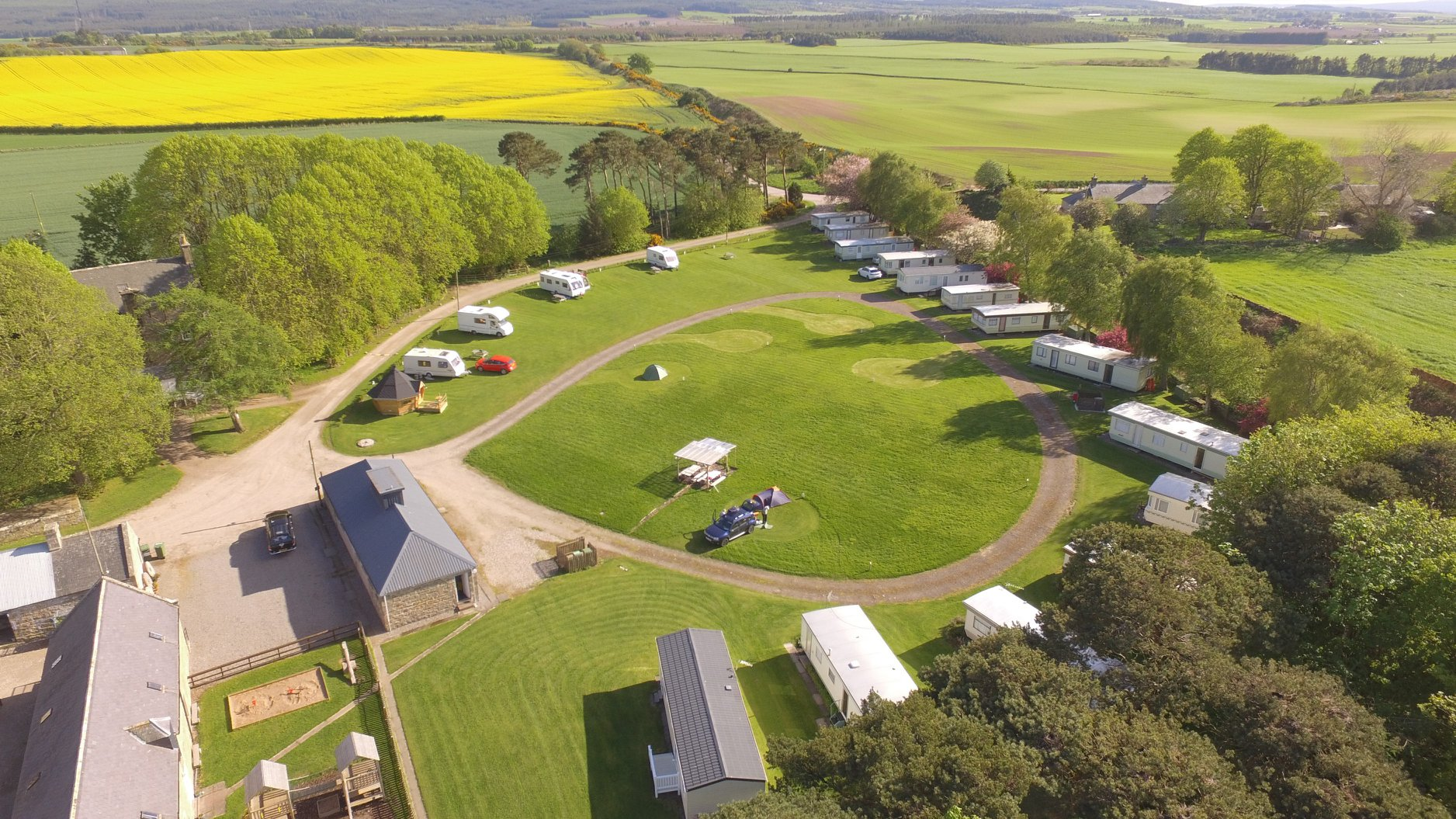 Drone shot of North Alves Holiday Park featuring campervans